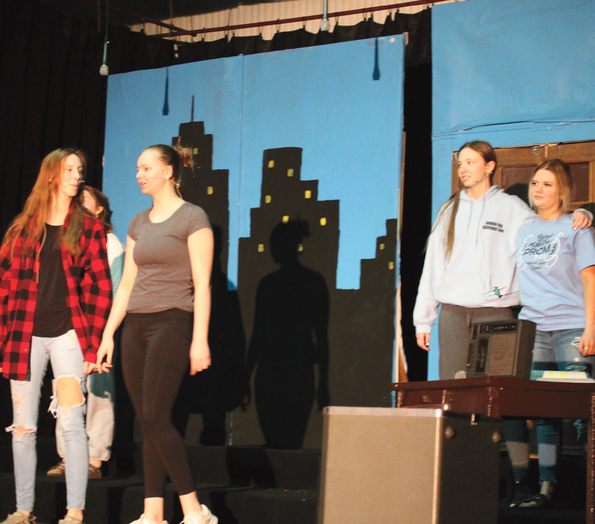 """""""Annie Jr."""" was performed this last week by the Iroquois High School. This was Mr. Darold Rounds's last production, as he will be retiring from teaching at the end of this school year. Pictured are Katie Dubro (hidden in back), Kaitlyn Konshak, Samantha Torguson, Rosalie Wehlander and Hannah Hofhenke practicing for the show."""