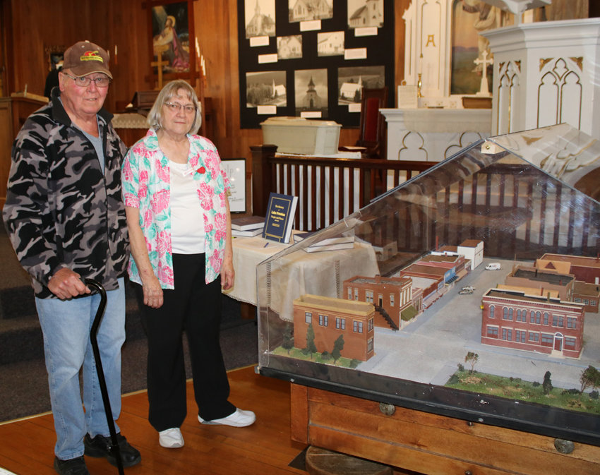 The Lake Preston Museum held its Grand Re-Opening Tuesday from 4-8 p.m. Darrel Tolzin and Roxann Casper view the Main Street Display and reminisce about days gone by and running from roof to roof as a kid. The museum is now lit with new track lighting that illuminates the displays well. Museum staff were on hand to tell visitors about their new displays.