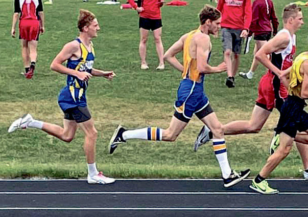 Rhett McMasters, above center, and Stella DeKnikker, right, sprint to finish out in the top spots to head to the State Track Meet held this weekend in Rapid City. Rhett will compete in the 1600m and 3200m dash and Stella in the 100m dash.