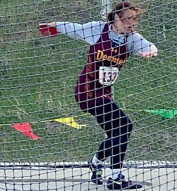 Mackenzie Zell throws the discus at the State Track Meet to get 2nd place.