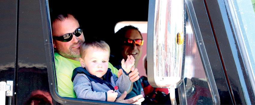 The parade on Friday afternoon was met with some beautiful South Dakota weather, making it a great time for the marching band, class floats, slogans, businesses and spectators to enjoy the annual parade. Above, Brian Zeeck and son, Loyal, along with driver, Josh Buer, wave to the crowd in the fire truck.