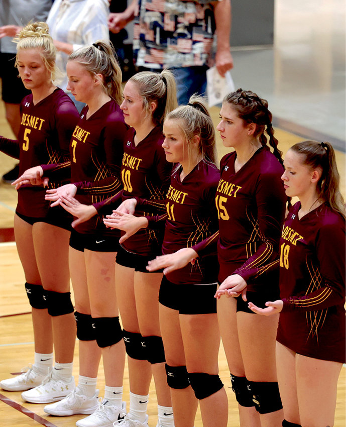 The starters get ready to play some volleyball.