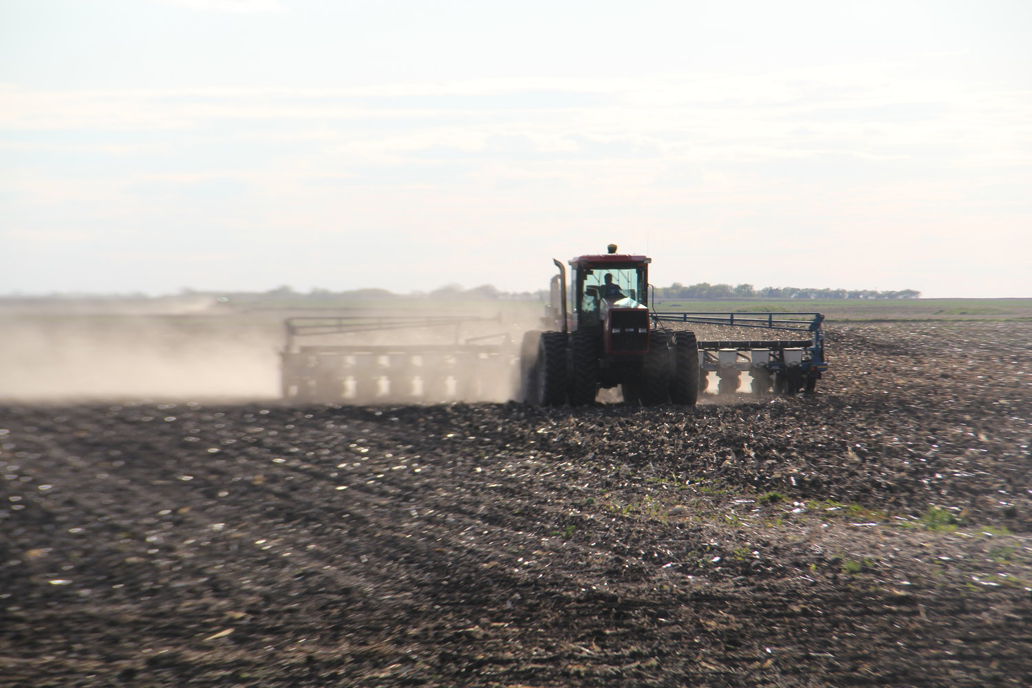 With better weather conditions this spring, farmers are working hard and letting the dust fly as they get fields ready for planting. Sporadic showers have stopped farmers occasionally, but overall, farming spirits are optimistic.