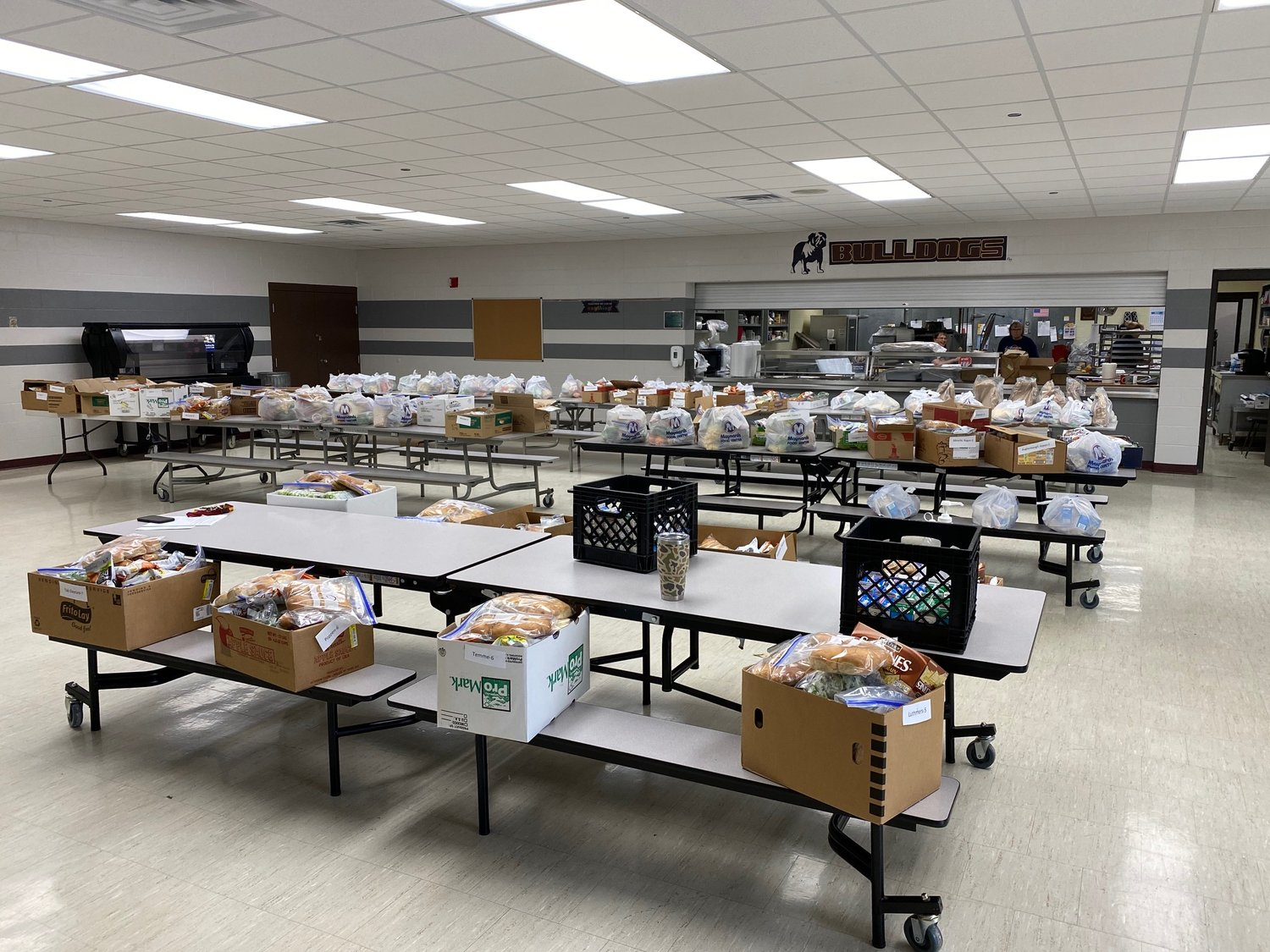 School lunches are prepared for weekly pick-up in the De Smet School District. Families and daycares picked up the meals in a drive-through model where school staff brought the food to the vehicles.