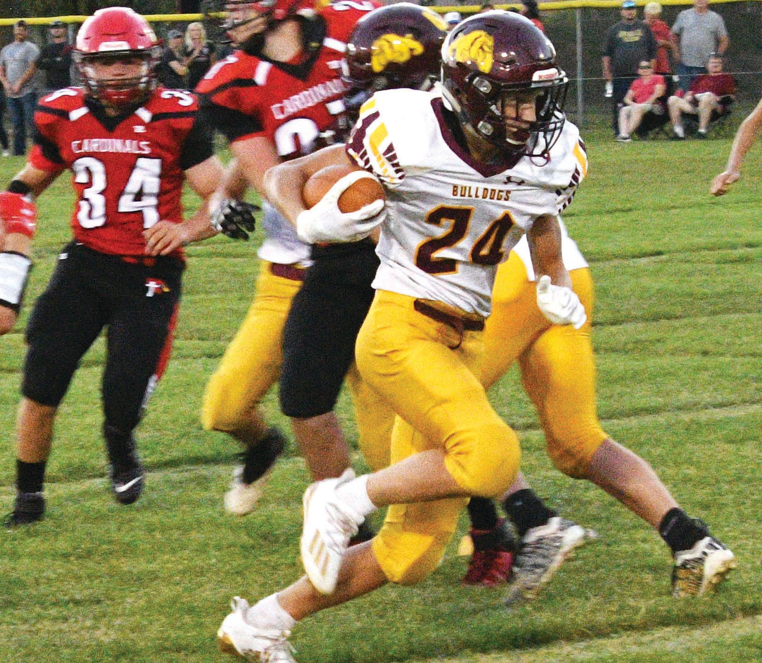 Kadyn Fast cuts hard around a good block, helping put an early end to Friday night's game in Dell Rapids.