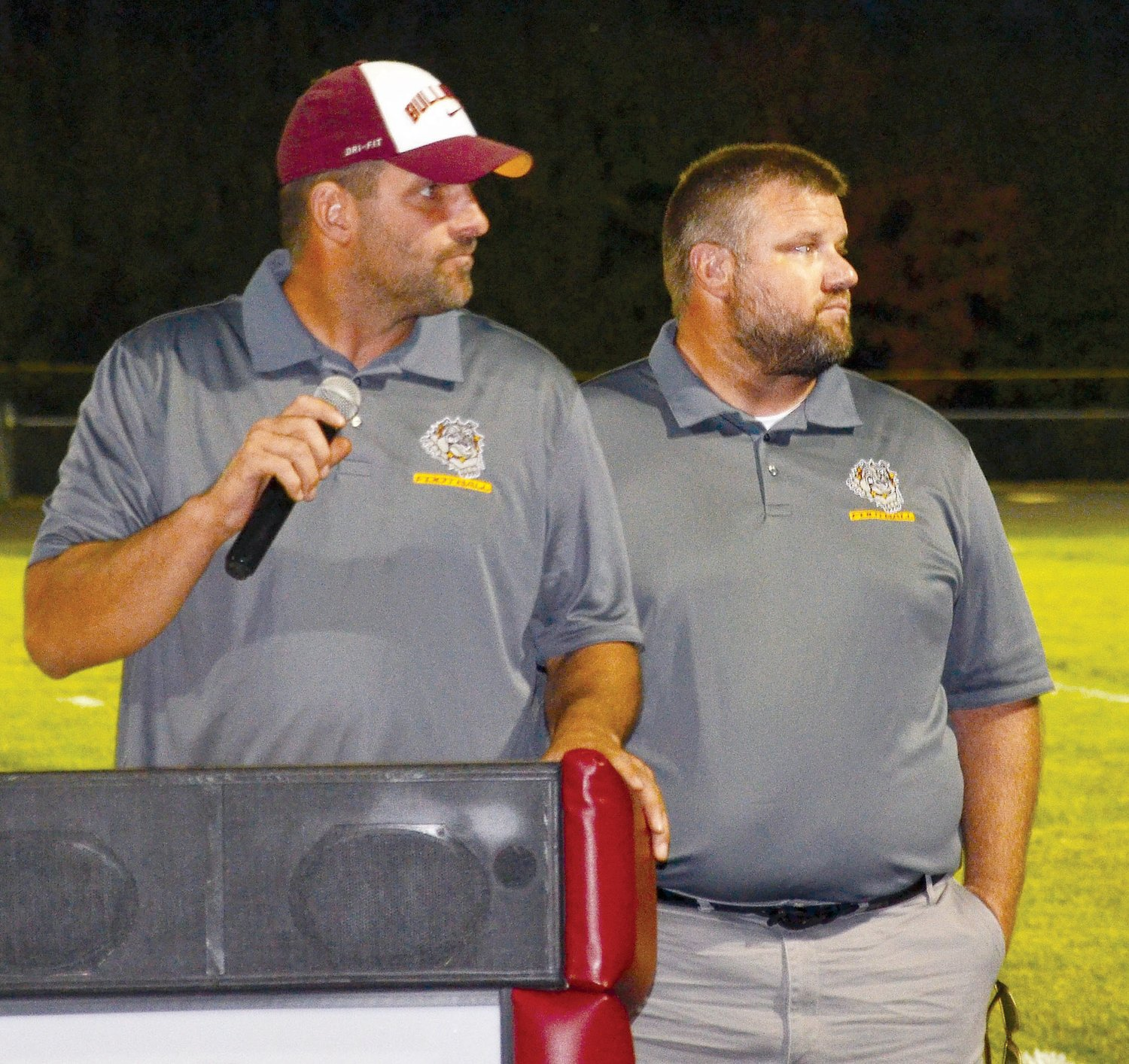Football coaches Dan Wilkinson, left, and Wes Clubb give an inspiring talk during coronation festivities.