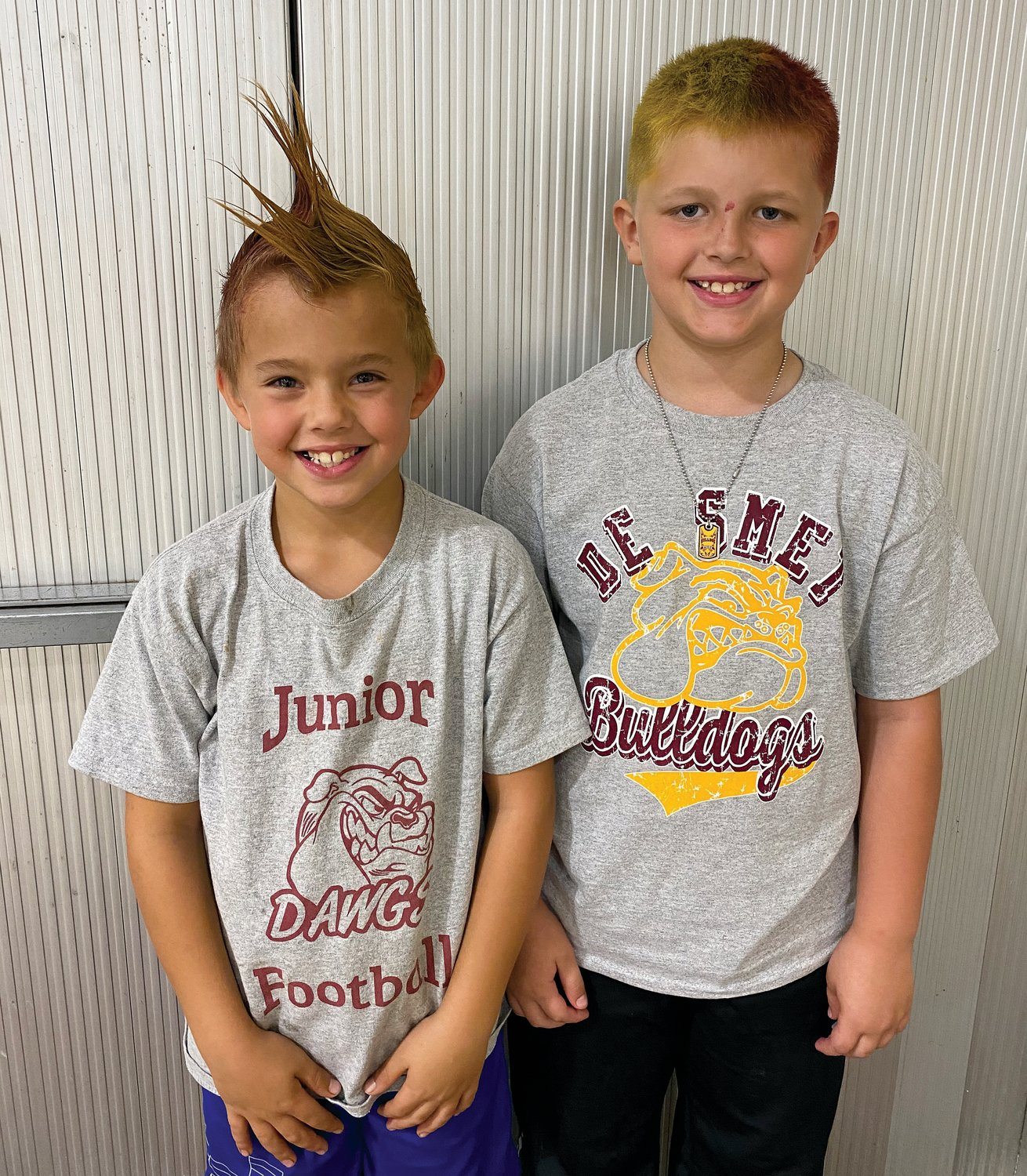 Second graders, Meyer Kees, left, and Casen Borah show off their school spirit on Friday.