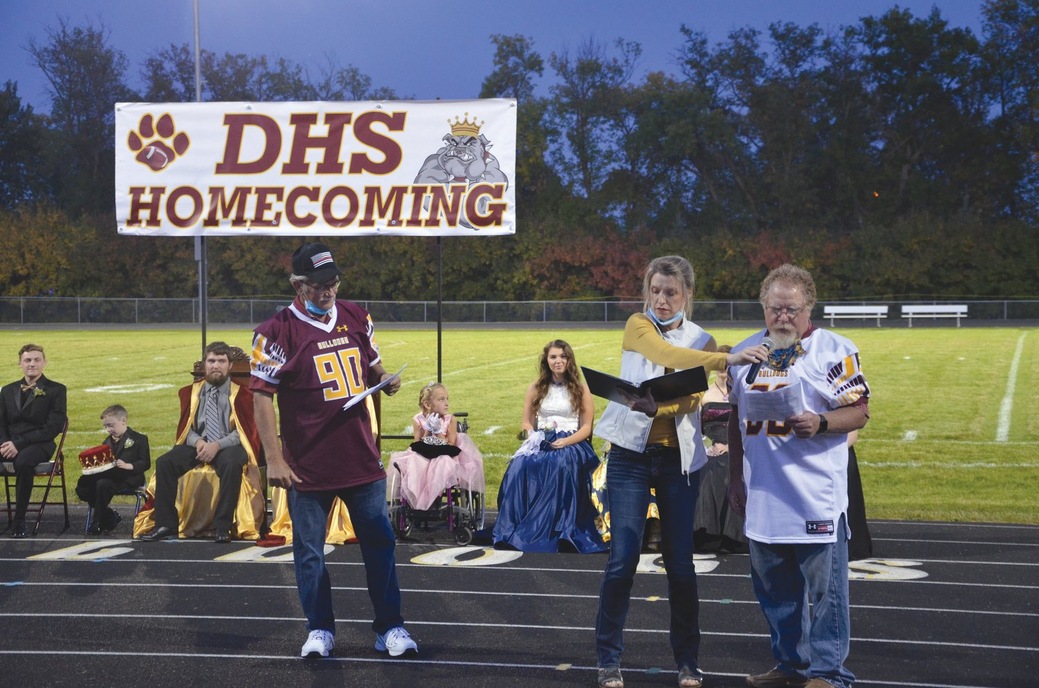 Former principal Larry Janish, DHS parent Tristin Gruenhagen and former DHS student Kyle Lee participate in a homecoming skit.