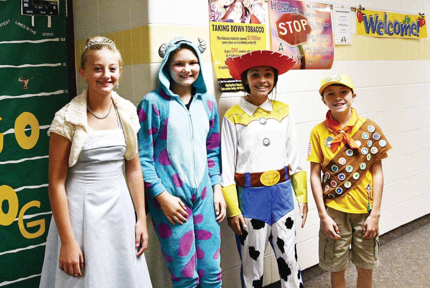 Brooklyn Coughlin, left, Audi Currier, Megan Dylla and Danny Sudenga dress up as characters from Disney on Disney Day.
