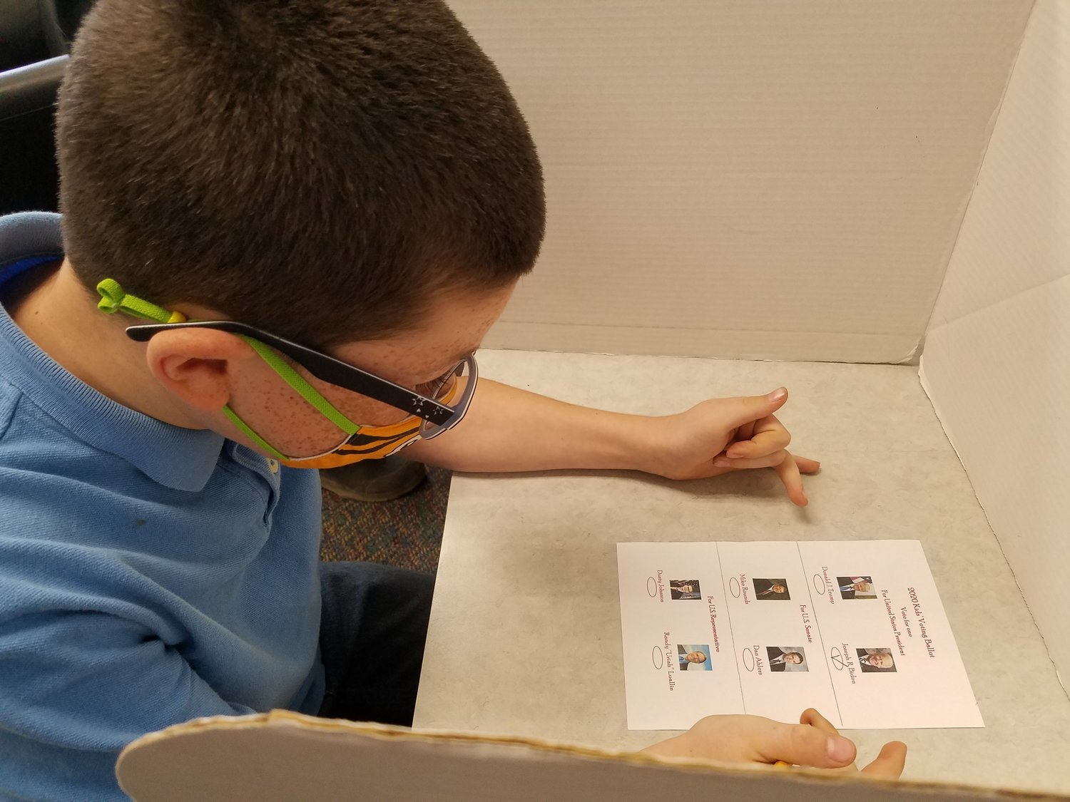 Fifth grader Conner Huls reflects on his choices before marking his ballot for the Iroquois Elementary Kids' Voting.