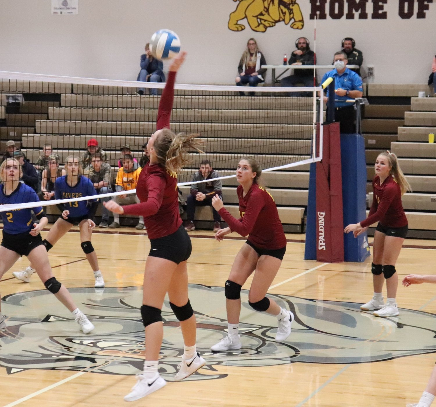 De Smet goes up for a spike against the Divers during the first round of districts.