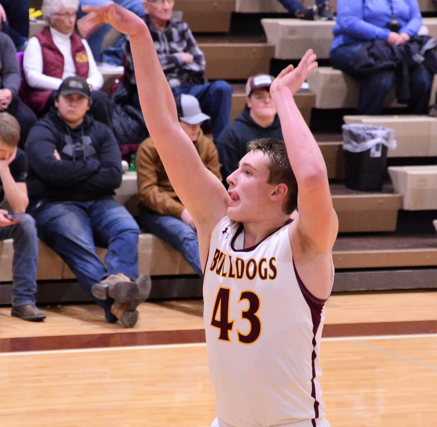Left: Damon Wilkinson shoots free throws at Monday's game against the Deuel Cardinals.