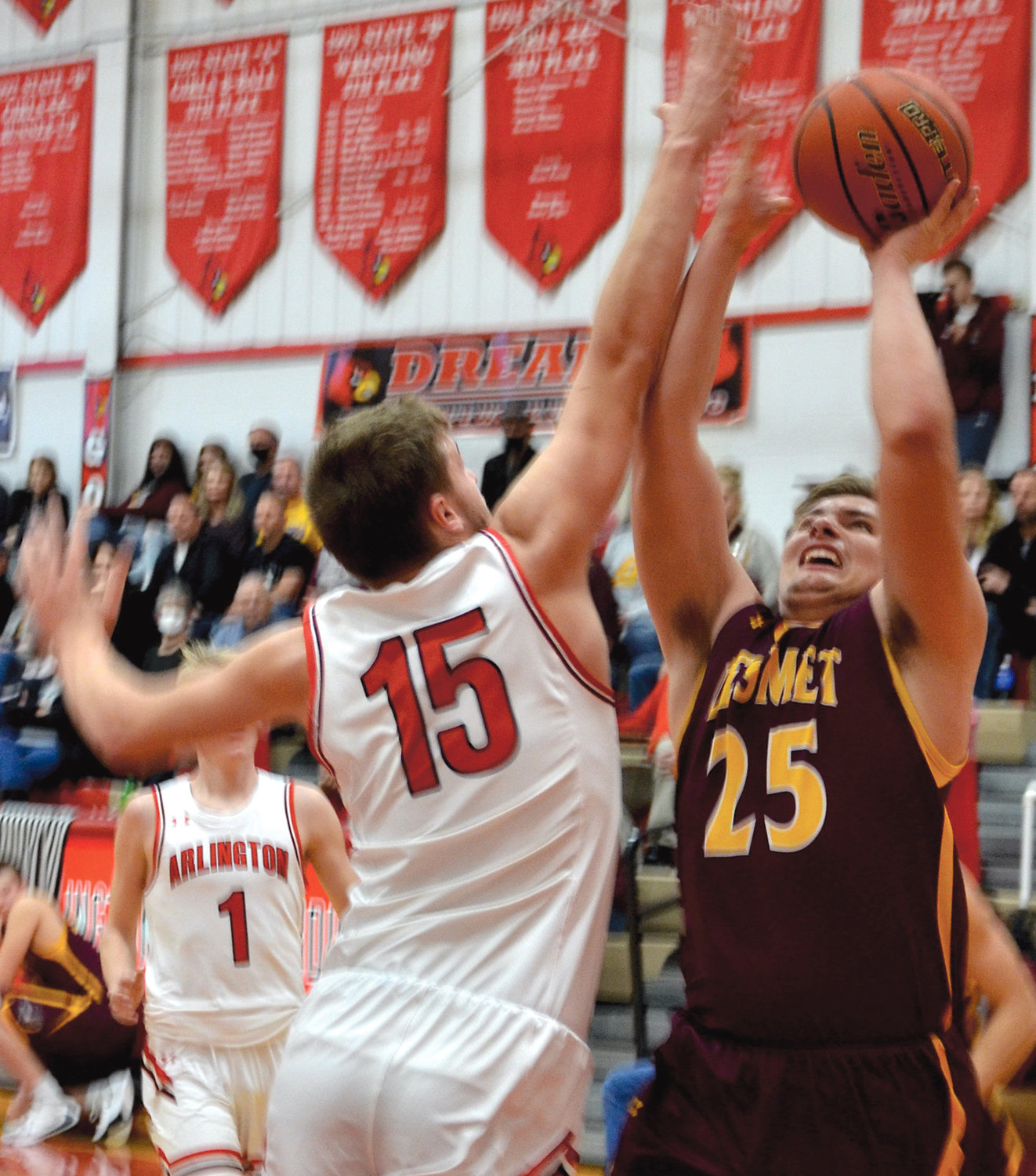 De Smet's Ethan McCune attempts a shot Jan. 8 past Arlington's Chris Wallace.