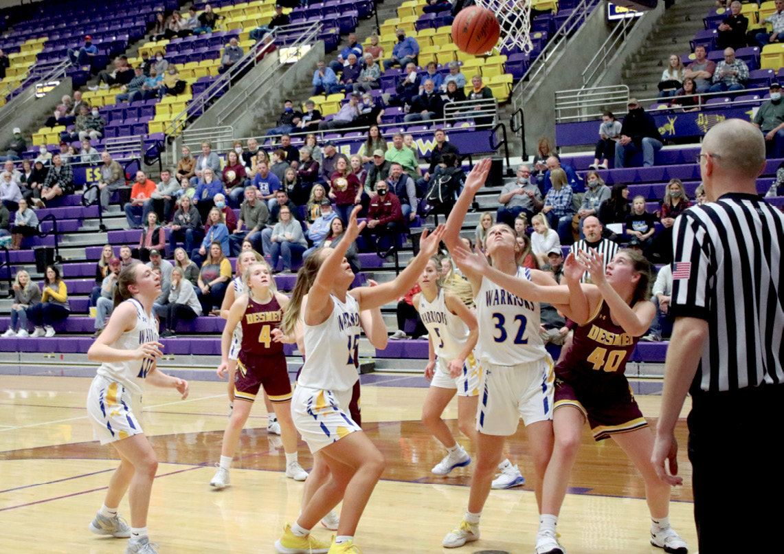 Kennadi Buchholz fights for position and the ball Thursday night at the Watertown Arena. The Lady Bulldogs' deep playoff run ended with a SoDak 16 appearance, losing to #1 seed Castlewood.