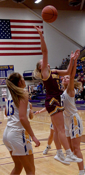 Emma Albrecht splits the defense and drives to the hoop in SoDak 16 action Thursday night.