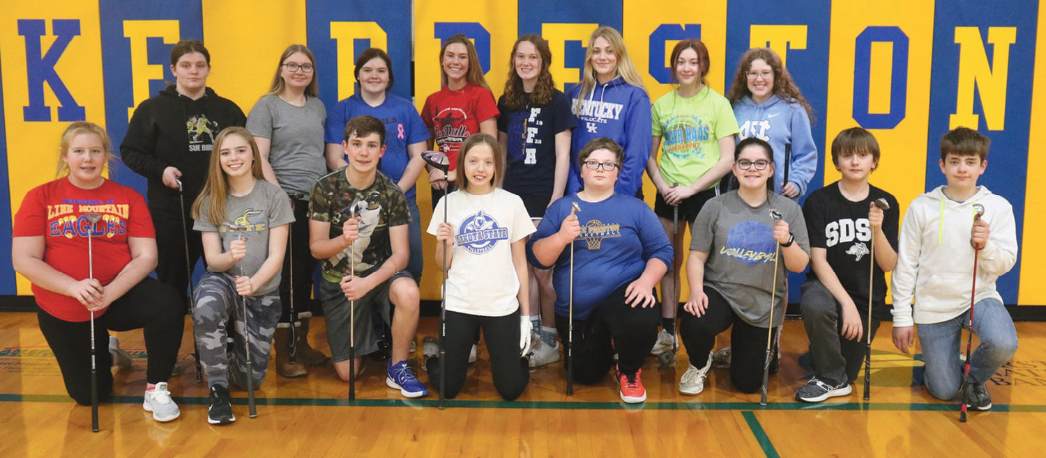 "The Lake Preston Golf Team has been practicing their skills, learning from Coach Nick Curd and Coach Kristi Curd. Golfers this spring are Kirsten Long, front left, Brooklyn Bothun, Benjamin Curd, Trinity Pirlet, Zack Perkins, Grace Greene, Lorick Pirlet and Rowdy Scheel. Amelia Greene, back left, Savanna Perkins, Maddison Rieck, Morgan Curd, Jocelyn Steffensen, Faith Steffensen, Alice Warne and Brooklyn Halverson. ""We are excited to get back to golf this spring,"" said Kristi Curd, ""We have a great group of young athletes who are showing improvements every practice.  What they lack in experience, they make up with enthusiasm and willingness to learn."""
