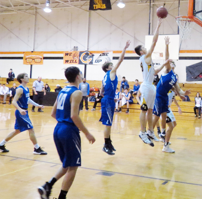 North Zulch's Richard Wiese goes up for a quick two during a tournament in Centerville over the weekend