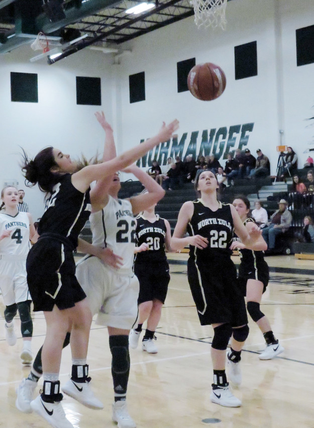 North Zulch Bulldog Cheyanne Wallin rejects a Normangee player from scoring during a road game.