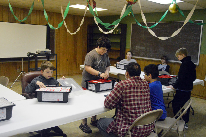 Caleb Rebstock, president of the Madison County 4-H Robotics club, addresses the club at the weekly meeting on Monday night.