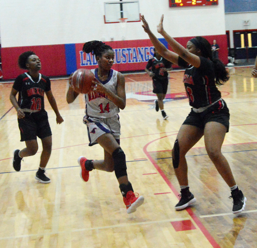Madisonville's Khyra Cooper drives to the hole in the second quarter of Friday's loss to Mexia in Madisonville.