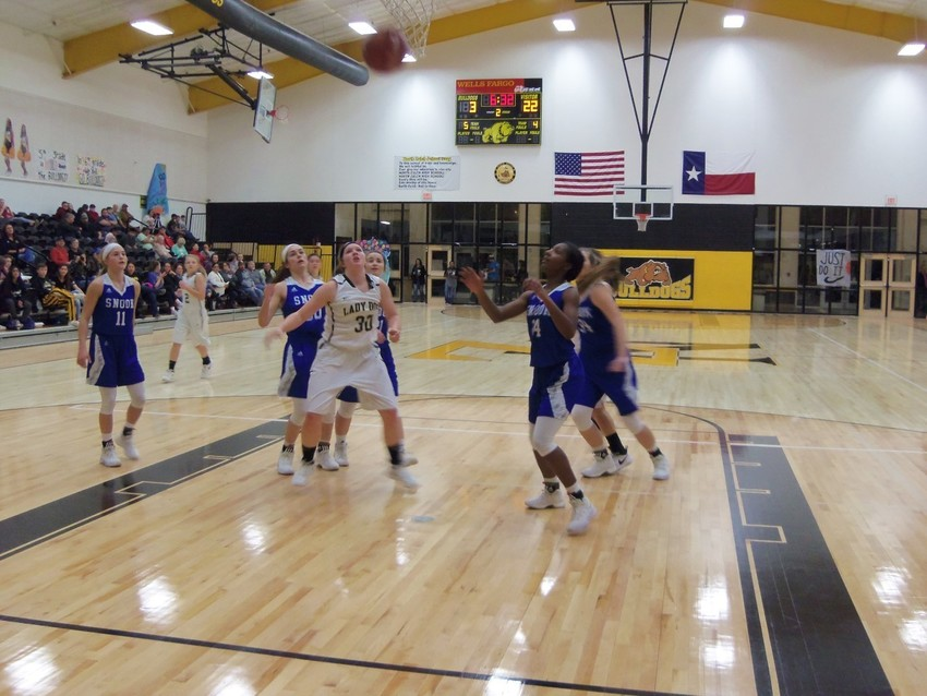 Madison Murphy (No. 30) of North Zulch awaits to make a move on a rebound in a Bulldog loss against Snook on Friday.