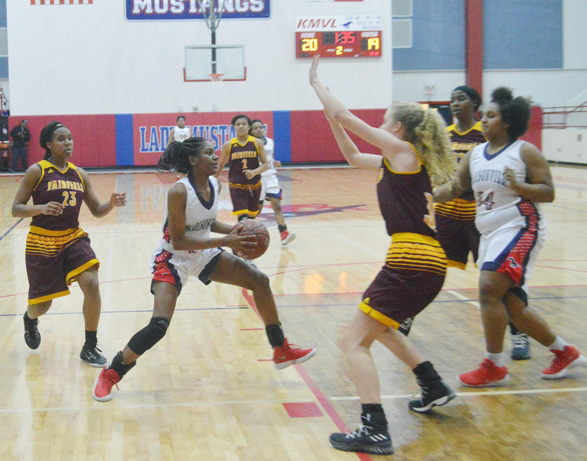 Madisonville's Khyra Cooper makes a move to the basket in the second quarter of last Tuesday's home loss to Fairfield.