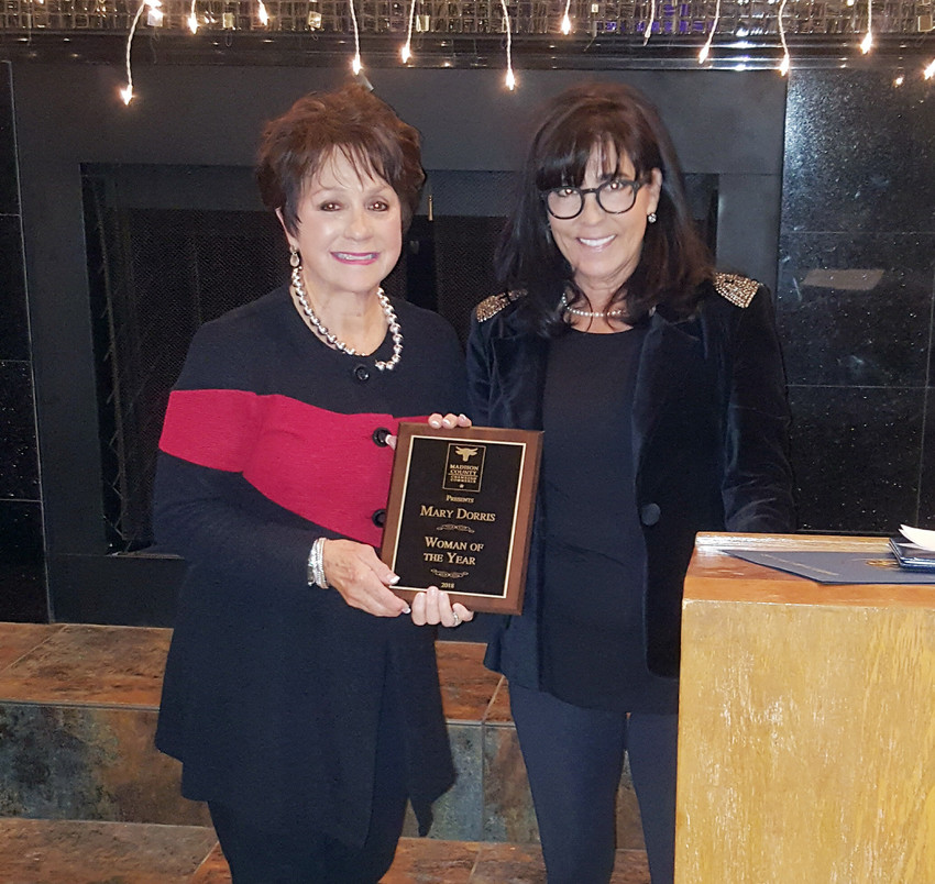 The Madison County Chamber of Commerce Woman of the Year is Mary Dorris, who was honored by last year's winner Dawn Knight.