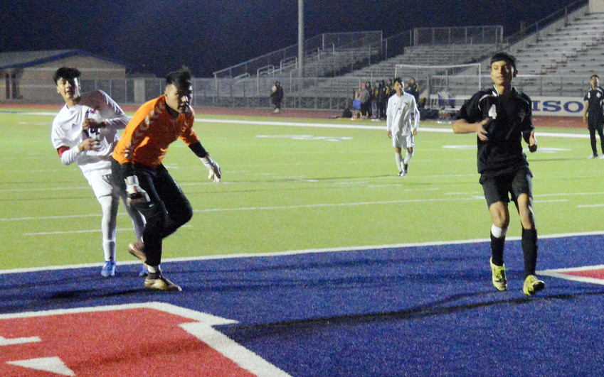 Luis Aceves watches the goalie chase after his go-ahead score to no avail in the second half of Friday's 2-1 win over Sealy.