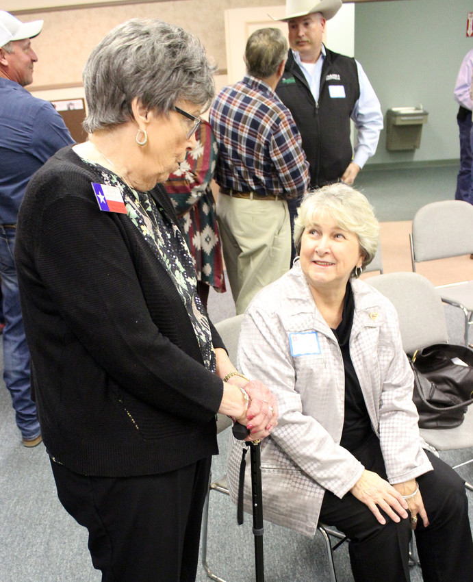 Republican Party Chair Betty Nosovitch (left) speaks with Susanne Morris, candidate for County Clerk, at the Republican Party Forum, held Friday at the Kimbro Center.