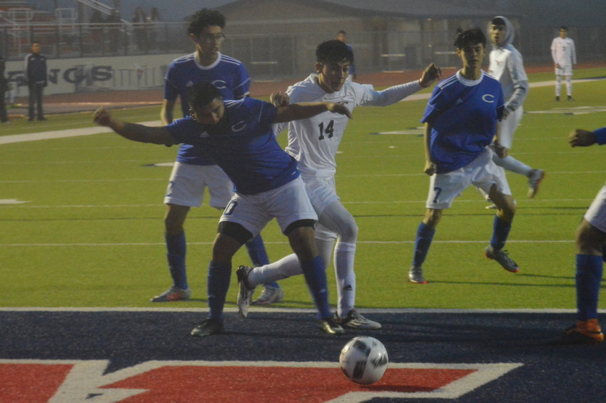 Madisonville's Luis Aceves battles a Crockett defender for the ball during a 6-0 Mustang win on Feb. 6.