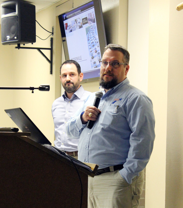 TxDOT engineers Andrew Holick (right) and Doug Marino discuss a project for a relief route for Highway 21.