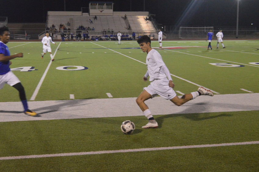 Madisonville's Mauricio Aceves winds up to launch the ball downfield into enemy territory.