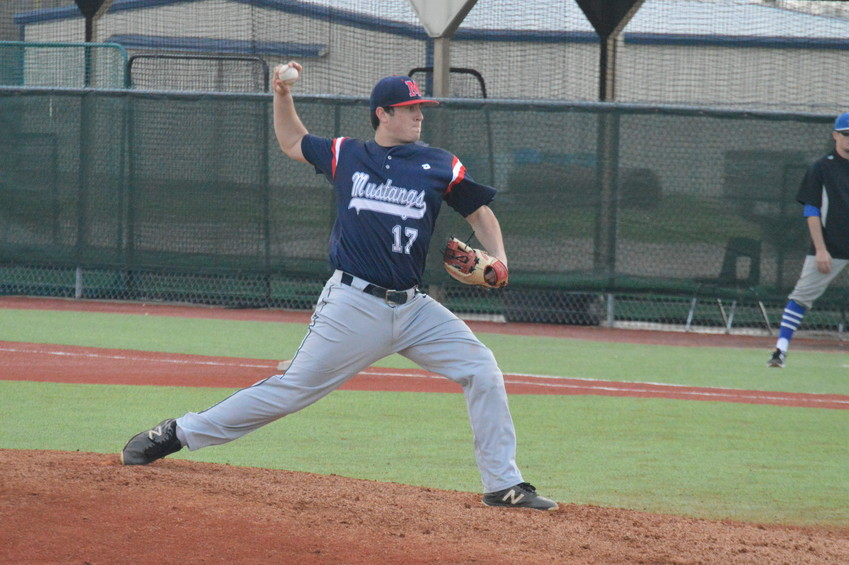 Madisonville's Zach Poe delivers a pitch during Friday's Madisonville Round Robin game against Navasota.