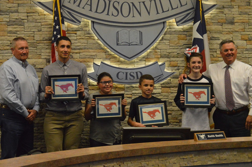 MCISD students of the month for February (from left) Cameron Hailey, Genesis Diaz, Malik Kovar and Grayson Bennett pose with Superintendent Keith Smith and board member Dennis McWhorter before Monday's meeting.