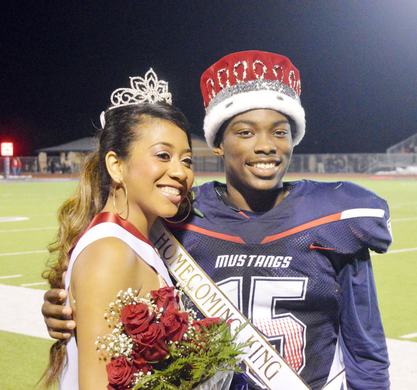 Homecoming King Johnny Simpson and Queen Kandace Smith pose after being crowned at halftime of Friday night's football game.