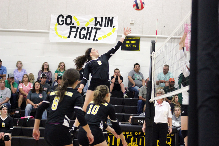 Senior Sally Osth attempts to finish off a kill in Friday's win over Normangee in North Zulch.