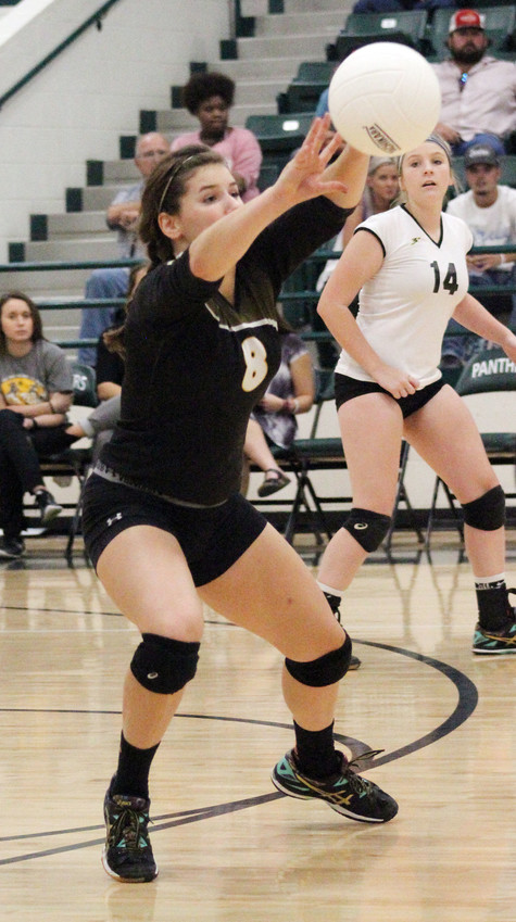 North Zulch senior Raegan VanCour sets the ball during a Bulldog