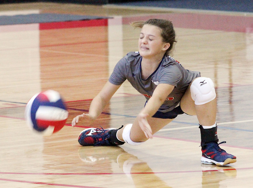 Madisonville freshman libero Sidnie Smith goes low for a ball in Friday's loss to Caldwell.