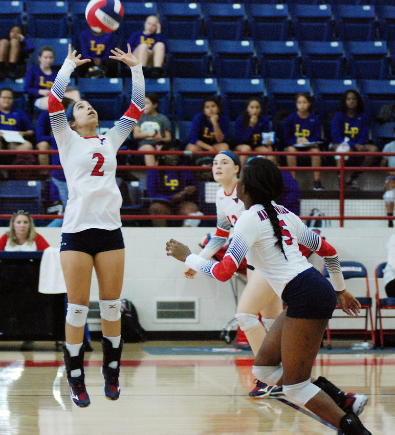 Freshman Raegan Olivera sets up sophomore Khyra Cooper for the kill in Friday's home loss to Lufkin.