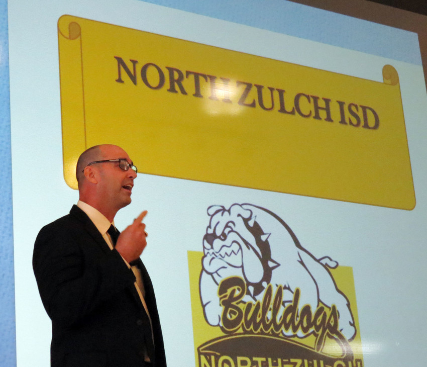 North Zulch ISD Superintendent Alan Andrus addresses a crowd gathered to discuss the school's future.