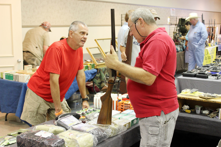 Gun enthusiasts and dealers interact during the annual Lions Club Guns Show, held Saturday and Sunday at the Kimbro Center.