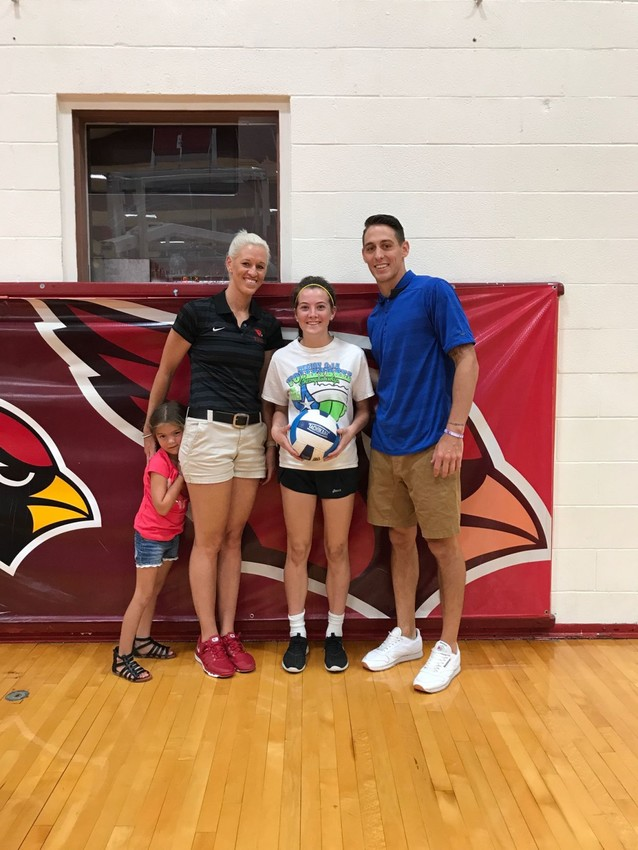 Robin Diserens poses with Coach David Graves (right) and Tosha Spain, head volleyball coach at Trinity Valley Community College and Spain's daughter.
