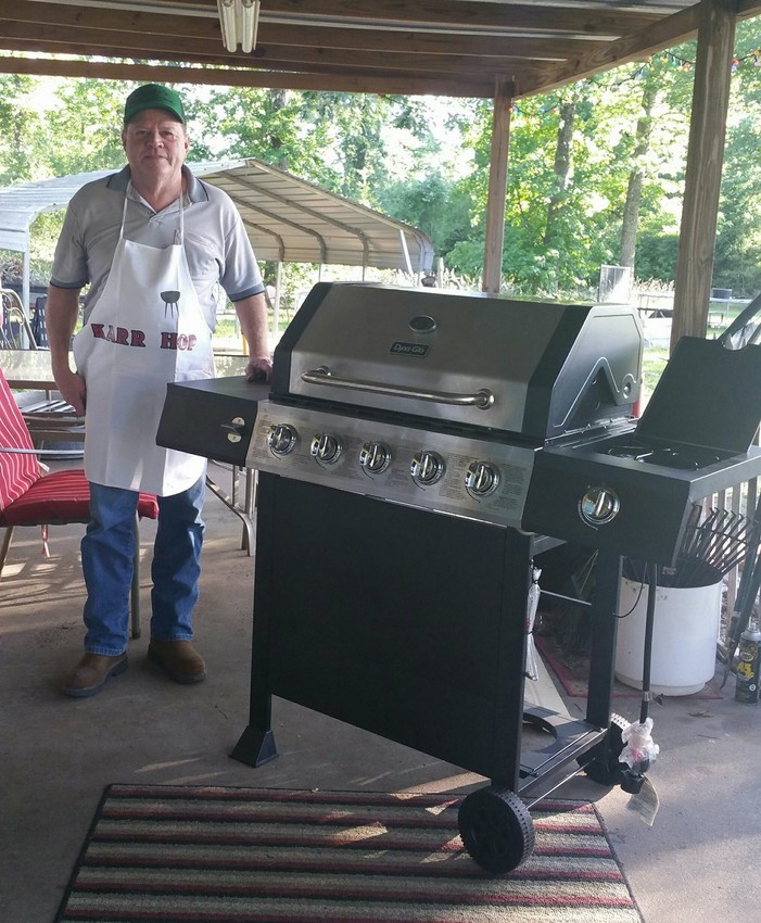 Jeff Karr won a gas grill, raffled off by The Cemetery Association of Midway at their annual fundraiser, held on April 29th at the Midway Church of Christ.