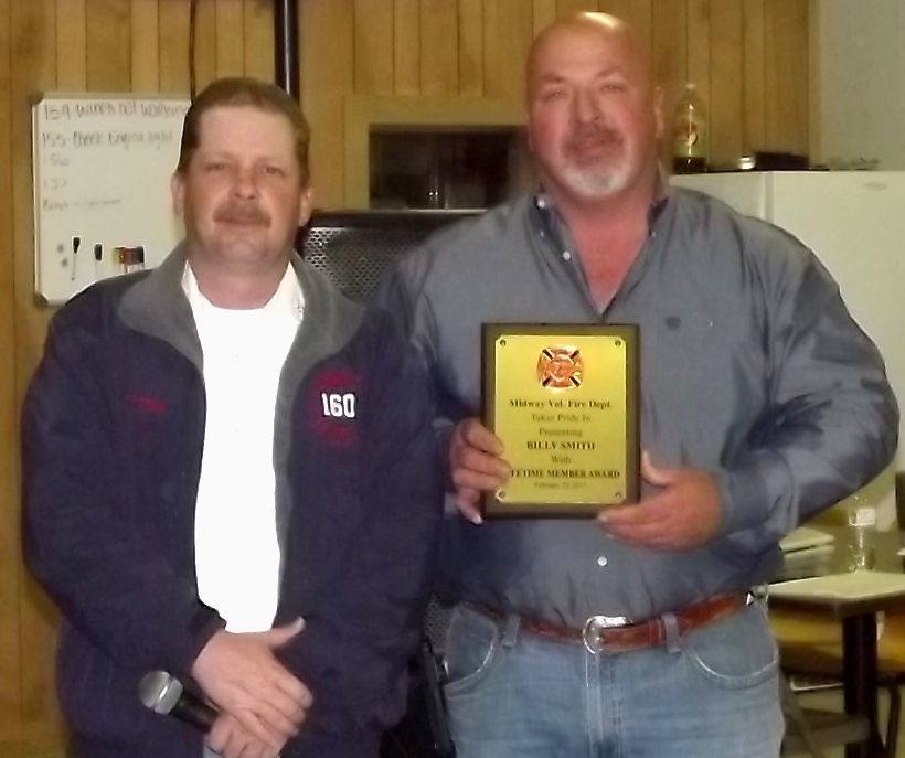 """Mike Ferguson, Midway Energy, accepts the Lifetime """"Member of the Year"""" award in the absence of Billy Smith at the Midway Volunteer Fire Department """"Po Bo"""" Steak Dinner."""