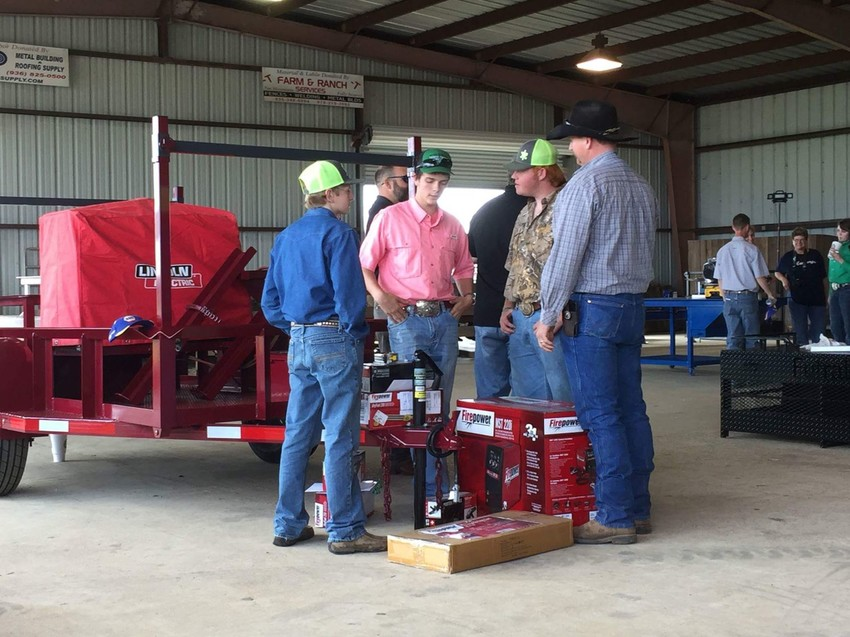 Mark Farris and project partner, Dallas Corbell, win first place in the Farm and Ranch Division of the Madison County Fair Ag Mechanics Show and Overall Grand Champion