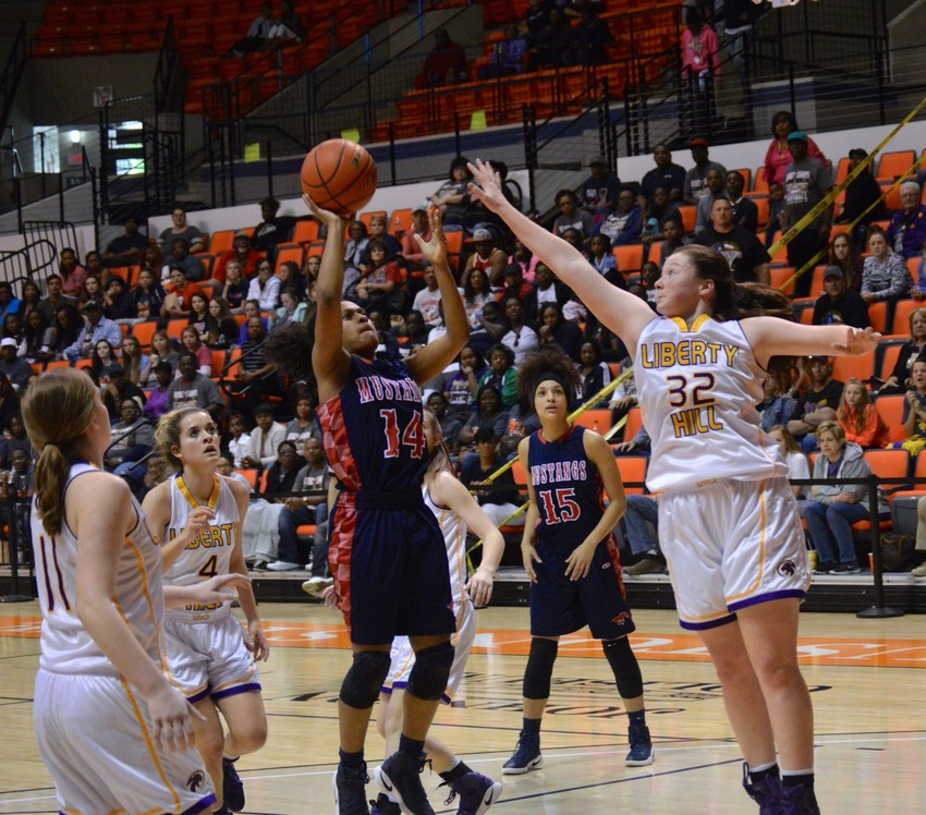 Tra'dayja Smith hits a floater in the lane during the regional championship game Saturday at Sam Houston State University.