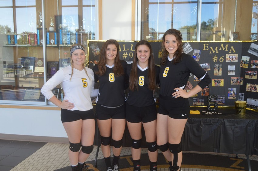 North Zulch volleyball seniors Cassidy Brown (No. 5), Raegan VanCour (No. 8), Emma Baker (No. 6) and Sally Osth (No. 9) pose before they were honored for senior night against Grapeland last Tuesday.