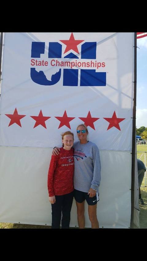 Madi Caperton (left) poses with Coach Jo Dorman at the UIL Texas Cross-Country State Championship meet in Round Rock on Saturday.