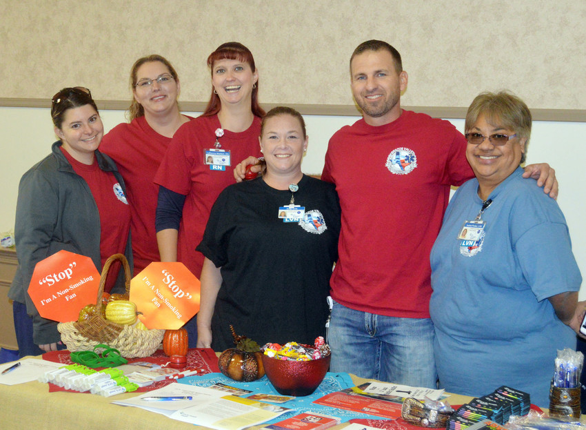 Nurses and volunteers from CHI St. Joseph's pose at their booth during the 21st Annual Healhfirst Healthfest at the Kimbro Center on Thursday.