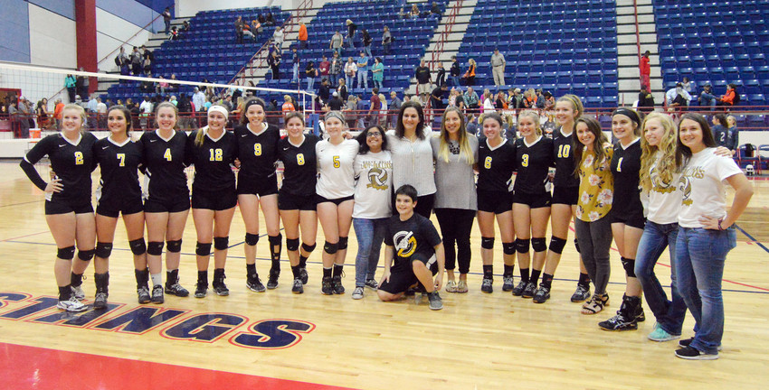 The North Zulch volleyball team poses together after their quarterfinal victory in straight sets over Centerville in Madisonville on Tuesday night.